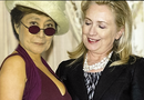 Hillary soaks up the view as Yoko gives us the eye!