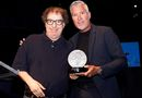 Dave Bookman (left) receiving his Unsung Hero Award from Slaight Music President, Derrick Ross. Pic: David Leyes