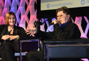 "Denise Donlon and Robbie Robertson chat by ""the Fireside"" (photo: Grant W. Martin Photography)"