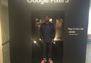 Co-founder Ahmed Ismail standing in front of a gallery of  the first successful HXOUSE venture with Google