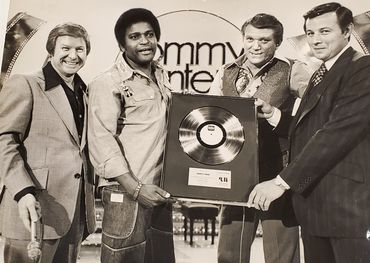 1976 gold record presentation (l-r): RCA president Ed Preston, Charley Pride, Tommy Hunter and Tee Vee Records' founder Ed LaBuick.