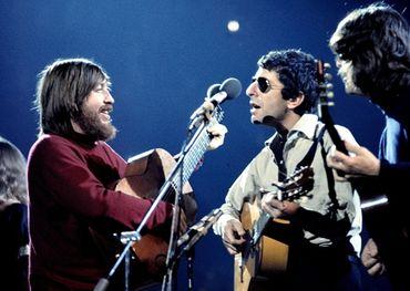 Bob Johnston, Leonard Cohen, and Ron Cornelius in concert at the Royal Albert Hall in 1973