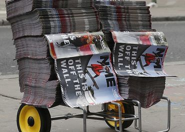 A cart near Camden Tube Station filled with the final print edition of NME. Pic. Daily Mail
