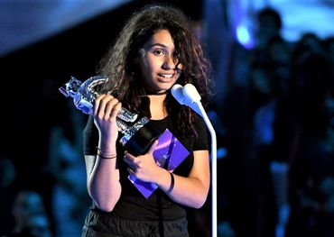 Alessia earlier this year holding her MTV Moonman Video award
