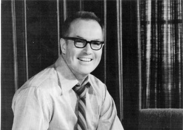 Allan Waters, circa 1970, sitting on his desk