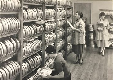 An earlier day view of a CBC transcription library room.