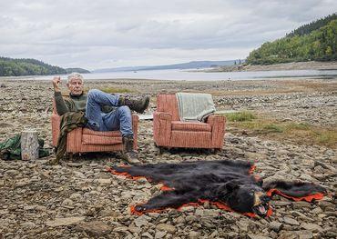 Anthony Bourdain kicks back on a beach in Newfoundland.
