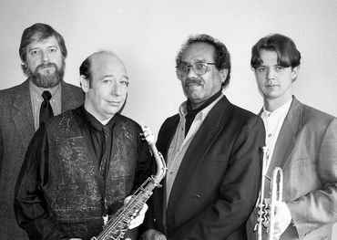 Archie Alleyne (second from right) with Don Thompson, Bob Mover, and Jake Wilkinson