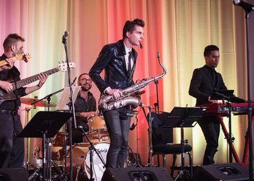 Award winner Eli Bennett funking it up on horn.