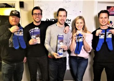 Indie88 staff receiving Babsocks — photo provided