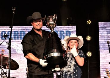 Gord Bamford and Make-A-Wish recipient Abby with the Grey Cup.  Photo: Two Stones Creative