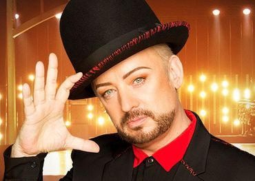 Boy George salutes the cast in Season 1.