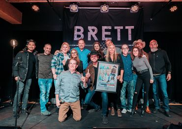 "Brett Kissel and the Warner & Invictus families celebrate #1 for ""Drink Of Me"" - photo: Ben Dartnell"