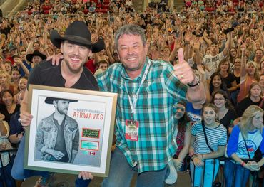 Brett Kissel celebrates success with Steve Kane. Photo: Barry Roden