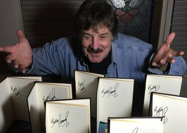 Burton with signed copies of his book