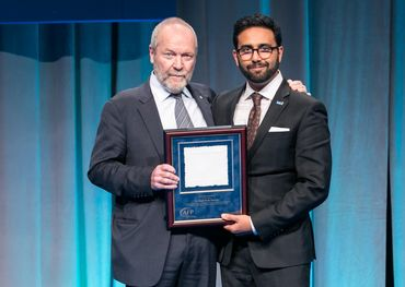 On behalf of the family foundation, Gary Slaight receiving his award from AFP Greater Toronto President Krishan Mehta. Photo: Joel Nadel, Event Imaging