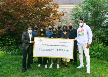 """From L to R: Michael """"Pinball"""" Clemons, Timothy Matongo, Amina Mohamed, Jeffrey Remedios, Kianah Dames, James Andrews, Michelle Anderson, Kevin """"Ice"""" White and Kardinal Offishall."""