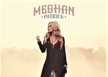 """Meghan fisting """"Country Made Me Do It"""" on her album cover"""