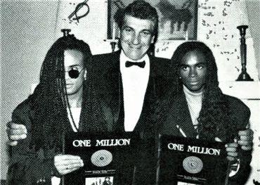 Following the Juno Awards ceremony in Toronto,  Milli Vanilli receives a Diamond Record awards from BMG GM Don Kollar.