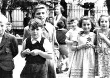 Photo of Jewish children in Terezin taken during a Red Cross inspection.