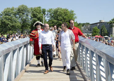 Kingston Mayor Bryan Paterson (left) and Patrick Downie (right) cross the bridge from Breakwater Park to the new Gord Edgar Downie swimming pier.  Photo: Swim Drink Fish