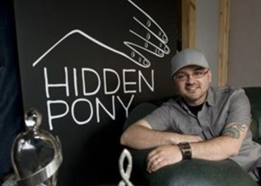 """Parkside Mike"" Renaud at the Hidden Pony offices. His acts have won Junos and Hamilton Music Awards. - Kaz Novak,The Hamilton Spectator"