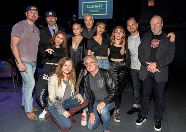 """The Slaight Music Fall roster with """"Parkside"""" Mike Renaud (2nd from L) Derrick Ross (centre), Ali Slaight and Jim Campbell front centre, and Gary Slaight on the far right."""