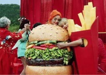 """Katy Perry and Taylor Swift in the """"You Need To Calm Down"""" video — screencap via Taylor Swift YouTube channel"""