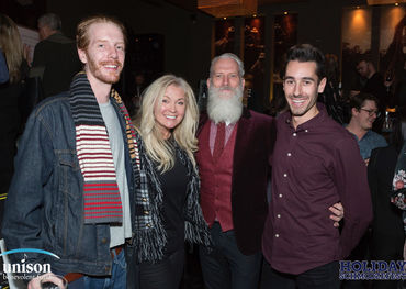 Fashion Santa Paul Mason with happy Schmoozefesters  Photo: Barry Roden
