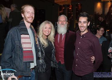 Fashion Santa Paul Mason with happy Schmoozefesters  Photo: Barry Roden