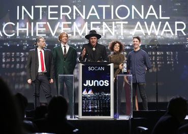Win Butler and band accepting the first of two Juno awards.