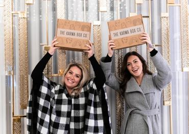 Erin McDonald and Kat Rose of The Karma Box Co. with the Winter Box — photo credit: Laura Wickware.