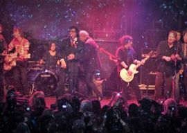 Alex Lifeson, Ron Sexsmith and members of Broken Social Scene and Barenaked Ladies joined Andy Kim onstage on one of his earlier Christmas shows.