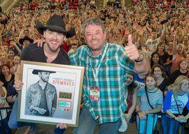 Brett Kissel celebrates success with Steve Kane. Photo: Barry Roden