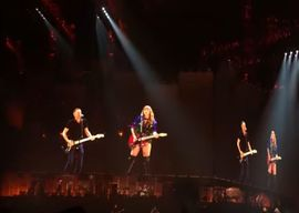 Bryan Adams on stage with Taylor Swift performing
