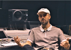 """Rapper SonReal at Toronto's Metalworks studio to record the anti-bullying song """"No More"""" for Telus — photo credit: screenshot"""