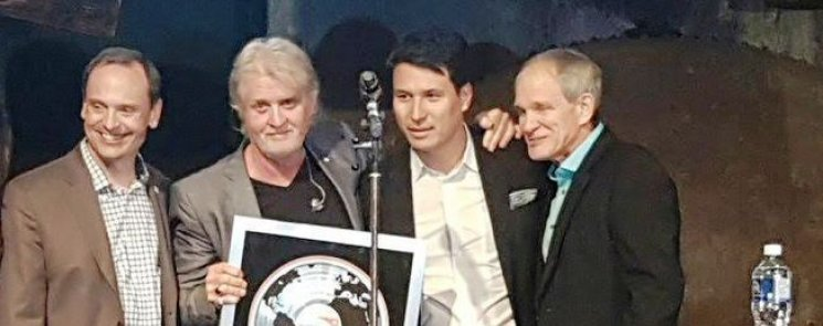Tom Cochrane with UMC CEO Jeffrey Remedios and World Vision friends on stage last night.