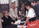 Bryan Adams signing autographs for fans