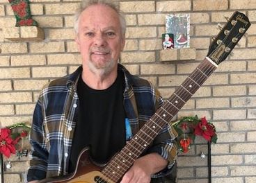 Myles Goodwyn with his recovered guitar