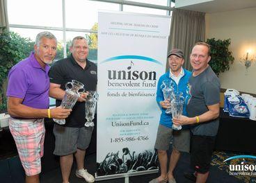 Slaight Music's Derrick Ross (l) with CEC Golf Classic winning team, Black Box Music. Photo: Barry Roden